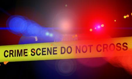 Crime Scene Tape And Police Lights